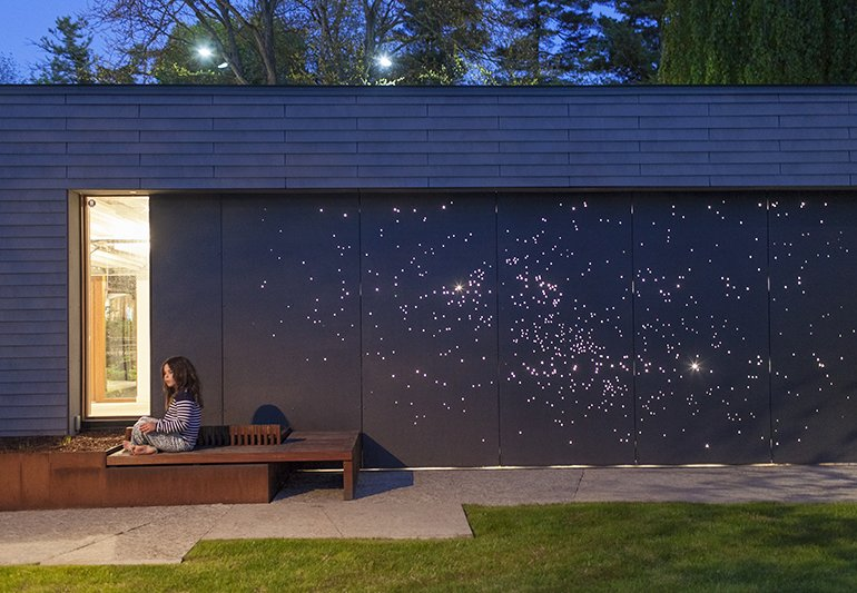 Exterior, House Building Type, Brick Siding Material, and Flat RoofLine Architect Janna Levitt laser-cut an astral pattern into the garage door of this renovated Toronto home, installing LED lights behind the fiber-cement surface to complete her depiction of the constellations Sagittarius and Scorpio.  Photo 3 of 10 in Guide to Understanding Laser, Plasma, and Water-Jet Cutting in Design from Unconventional Garages We Love