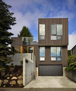 """""""BLK_LAB uses a series of thoughtfully placed windows to achieve a combination of passive solar design and an advanced thermal envelope,"""" says architect Christopher Patano, founder of Seattle firm Patano Studio Architecture. The home is insulated with cellulose, a material made from 85 percent post-consumer recycled content, which is densely packed into each stud cavity."""