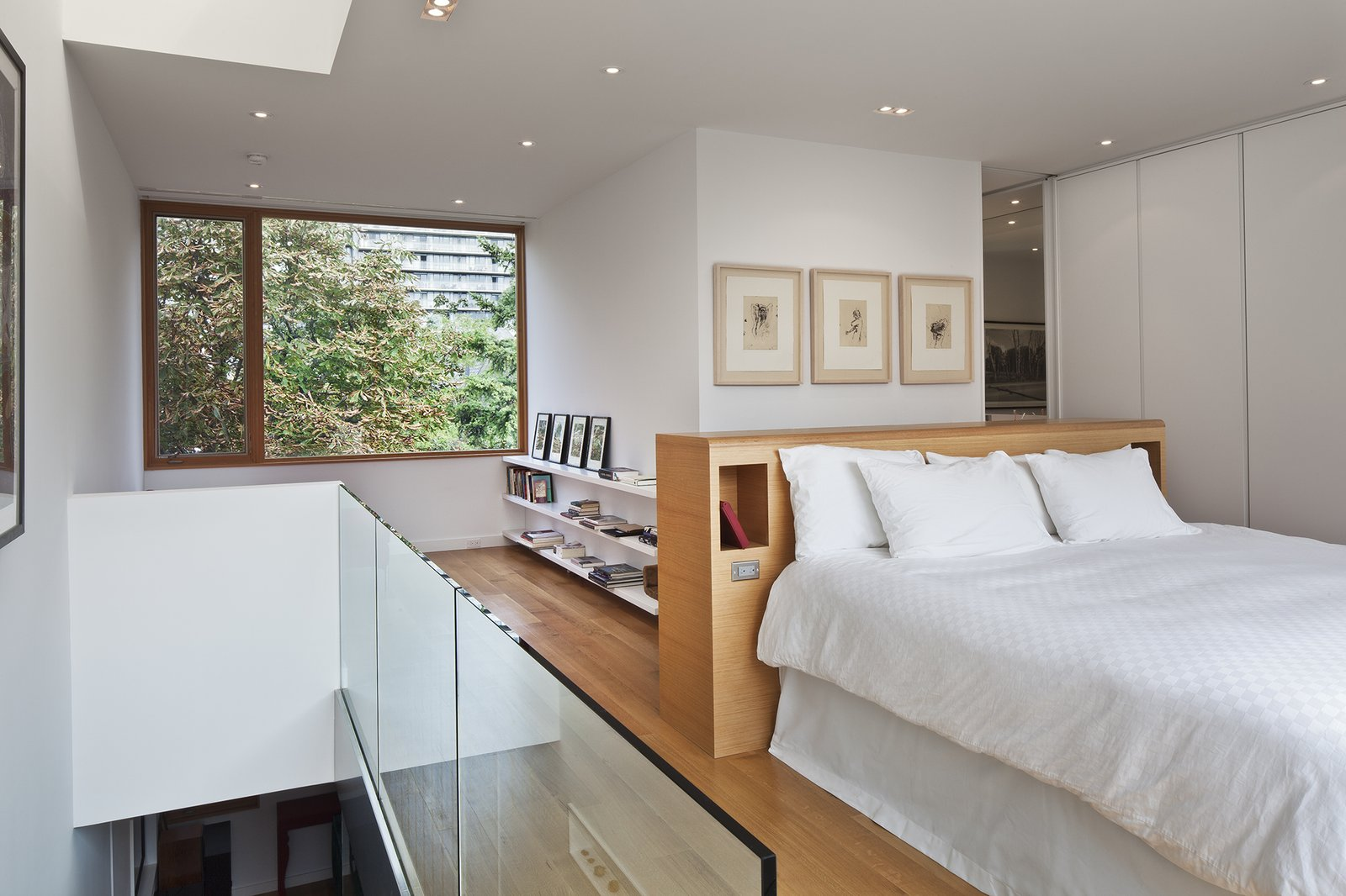 Benjamin Moore's Ultra White CC-10 was painted throughout the interior, including in the third floor's master bedroom. The house has five bedrooms, and two are used as personal offices.  King West by Kelly Dawson