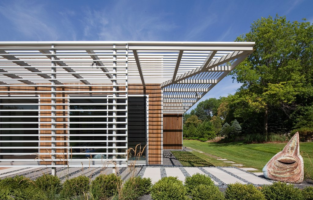 The work of Richard Neutra inspired Dolezal's rectalinear, low-slung design for the structure.  Omaha Art-Inspired House by Diana Budds