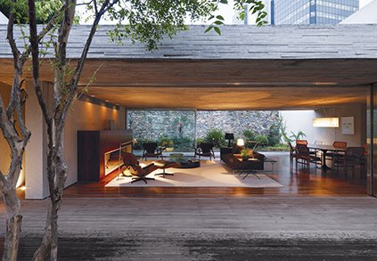 For photographer Reinaldo Cóser and his family of four, the best way to deal with the sometimes-draining throb of massive São Paulo was to simply rise above. By keeping the front and back gardens at the same elevation as the living area, architect Marcio Kogan created one giant living space. A large overhang means that even on a rainy day, the Cósers can live practically without walls. Photo by Cristóbal Palma.  Latin America's Best Modern Homes by Kelsey Keith