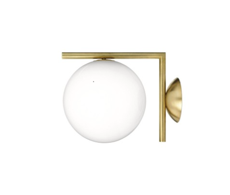 Part of a larger collection by Michael Anastassiades for Flos, the IC Lights C/W1 Wall Light is an elegant orb supported by a perpendicular steel stem.