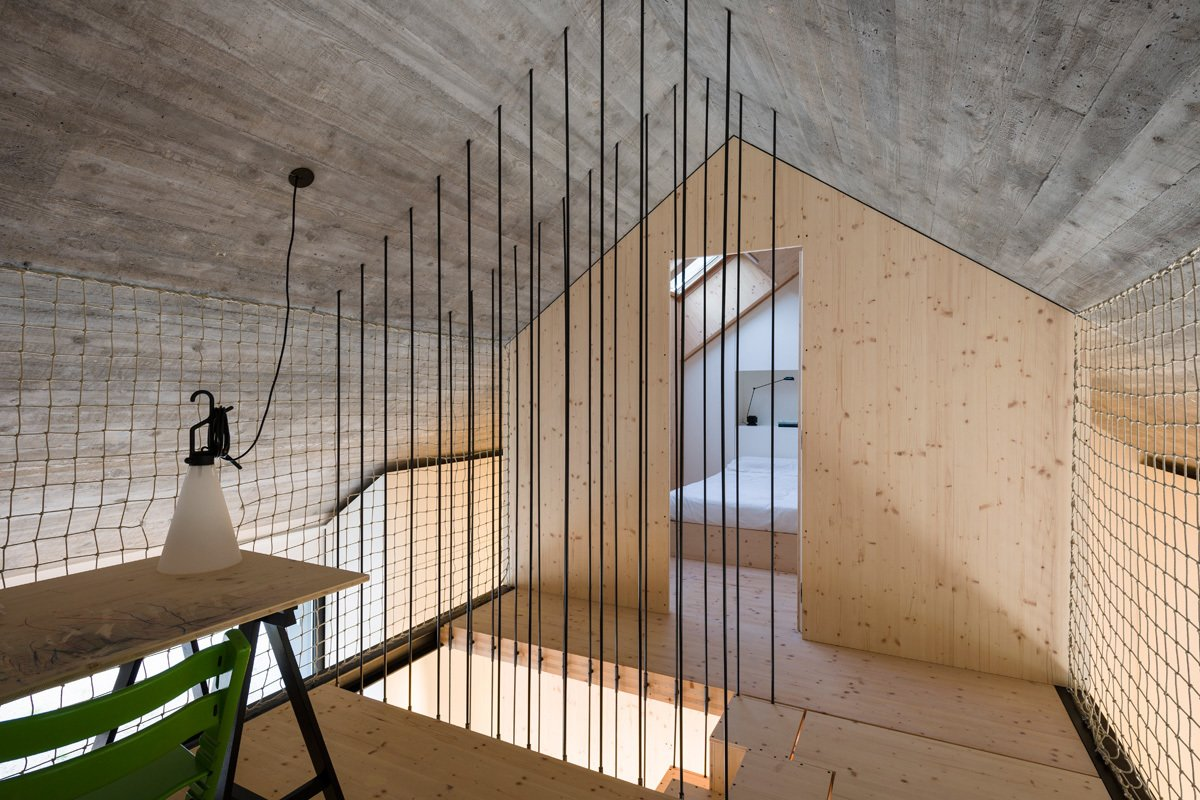 Office and Desk Steel rods surround the staircase. A MayDay lamp by Konstanting Grcic for Flos is affixed to the rope wall.  Clever Loft Spaces for Small Places by Diana Budds