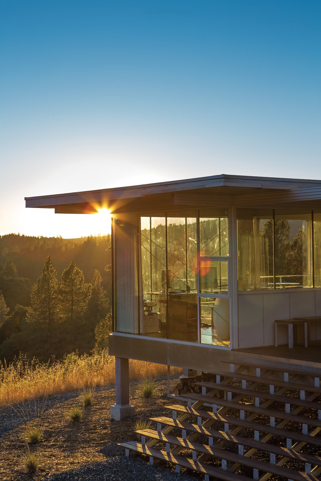 """Exterior, Metal Siding Material, Flat RoofLine, and Prefab Building Type """"I'm interested in designing things that are exactly what they need to be and nothing more."""" —Architect Linda Taalman  16+ Prefab Homes in the Middle of Nowhere from Mayacamas Residence"""