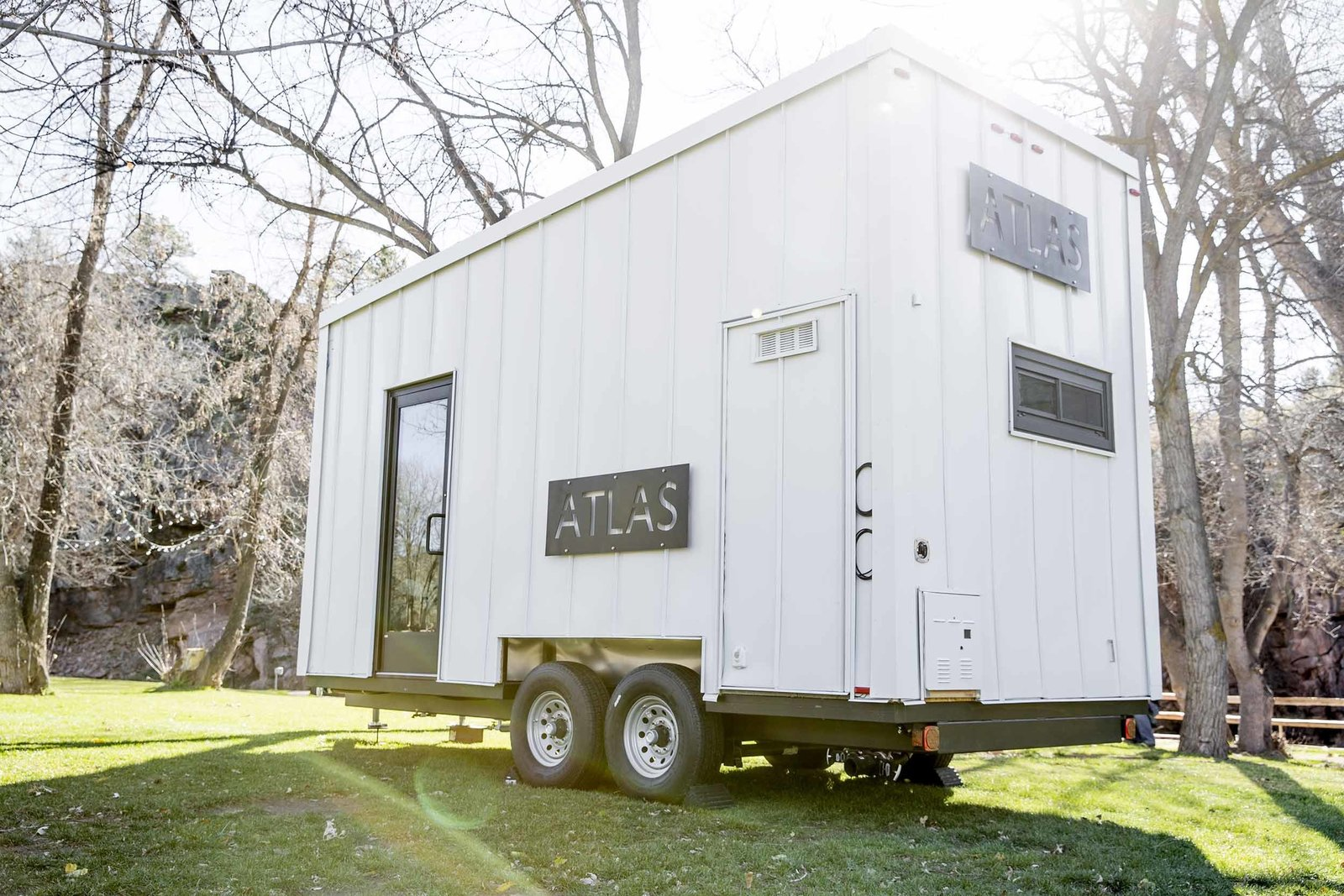 Rooftop solar panels and a rainwater filtration system minimize its dependence on the grid.  A Tiny Trailer Home Harvests Solar Power and Rainwater to Save Energy by Luke Hopping