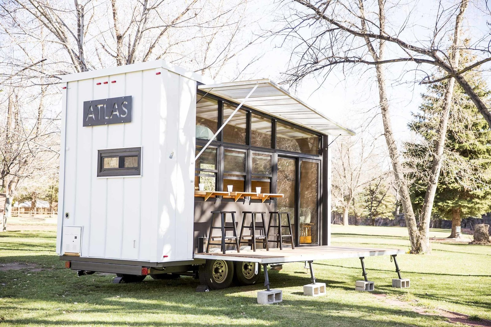 Exterior, Camper Building Type, and Flat RoofLine Unpacking the deck and awning reveals a glass wall that opens the trailer to its environment, wherever that may be. The ATLAS can be hitched to a truck to travel easily from campsite to campsite.  A Tiny Trailer Home Harvests Solar Power and Rainwater to Save Energy by Luke Hopping