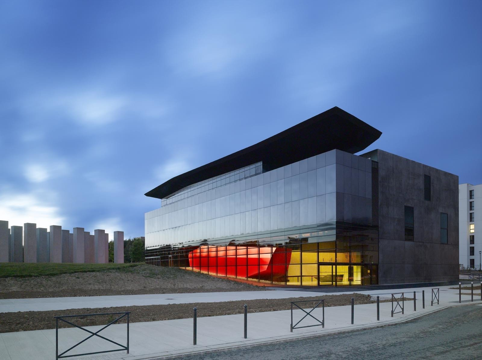 Decq designed the FRAC Bretagne Museum, a reflective glass structure that houses contemporary art, in Rennes, France.  Museums