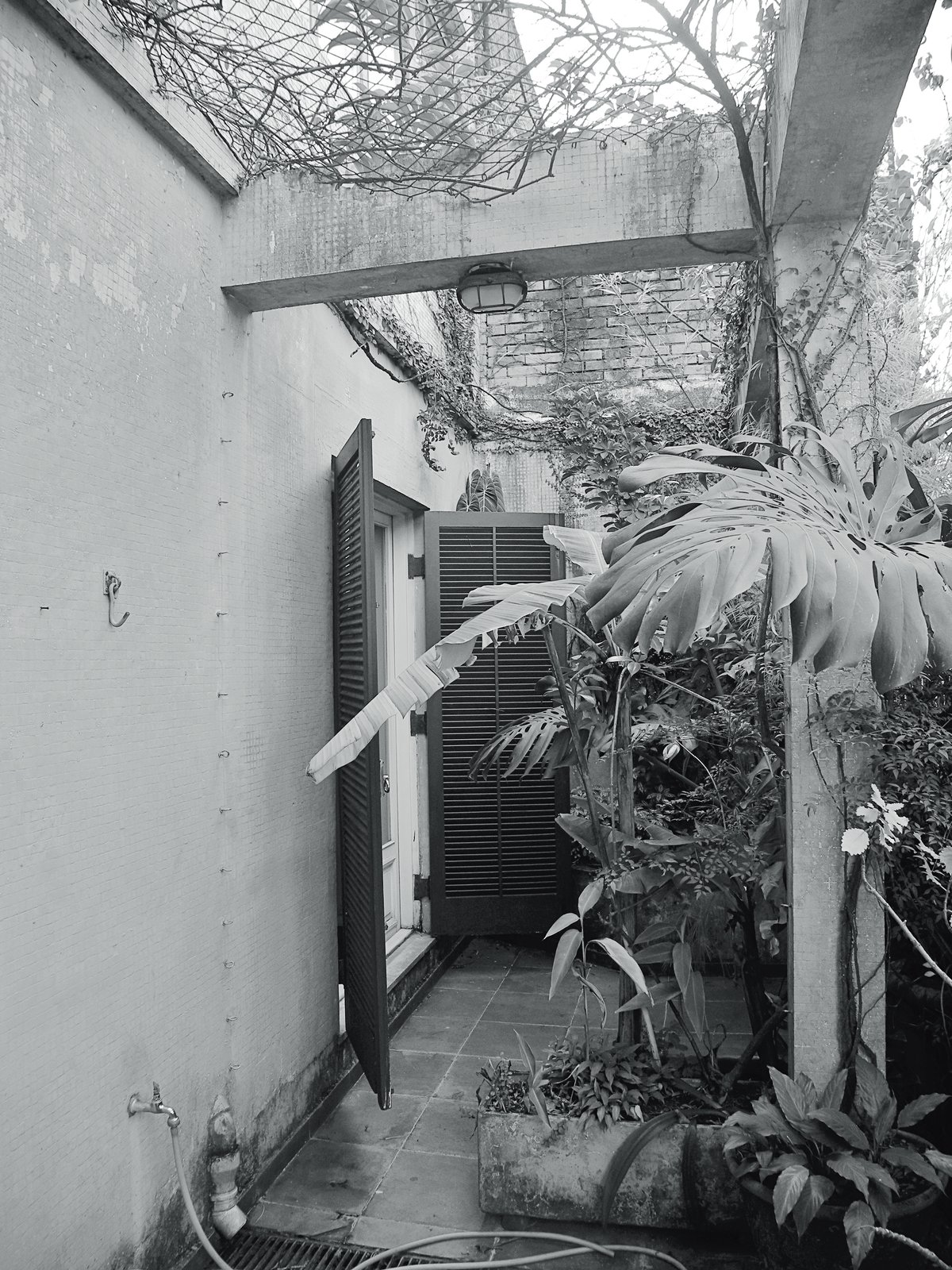 A shot of the terrace before renovation.  Photo 14 of 15 in Amazing Garden Oasis in São Paulo Born from a Five-Year Search and Renovation