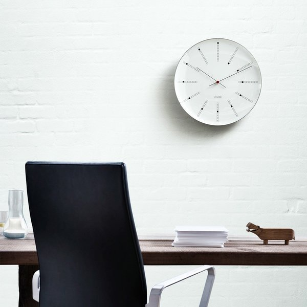 Designed by Arne Jacobsen for the Danish National Bank in 1971, Bankers Wall Clock has been faithfully recreated by Rosendahl. Its design uses a brilliantly simple scheme of boxes to balance simplicty with legibility.