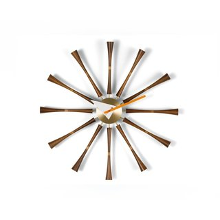 A work of American design icon George Nelson, the Nelson Spindle Clock sports twelve turned walnut spindles, accented with luxe brass, that mark the time.