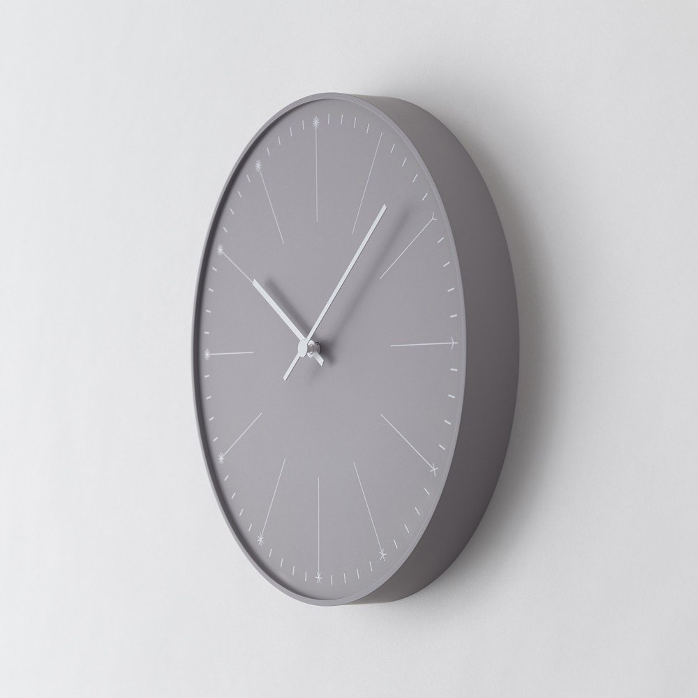 """Don't let its minimalism fool you: the Dandelion Clock hides a fun graphic display in plain sight. Instead of numerals, each hour mark """"dandelion"""" adds another petal, from one to twelve.  Search """"11plus world desk clock"""" from Wall Clocks for the Modern Home"""