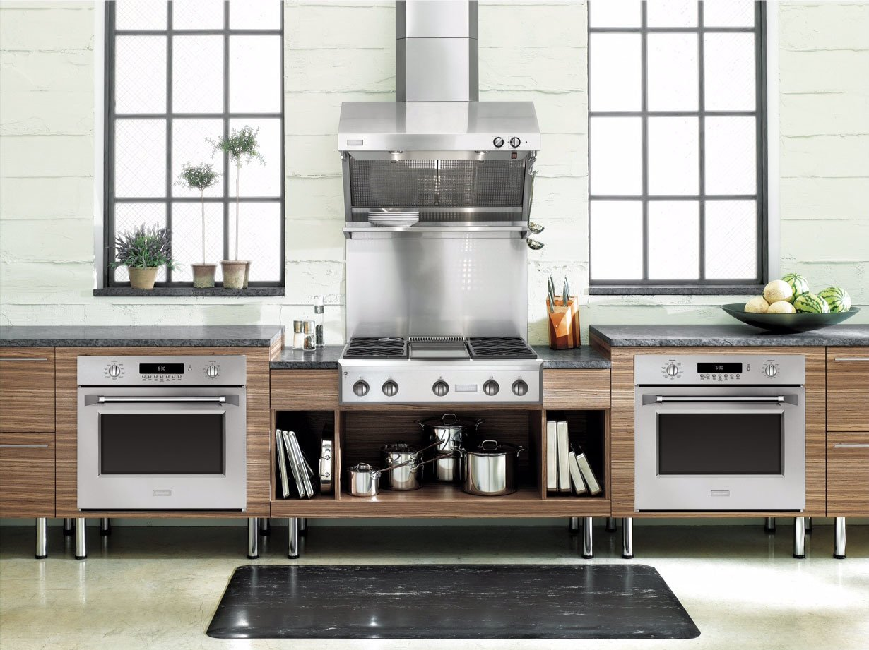 One trend that Marc Hottenroth, Monogram's Lead of Industrial Design Operations, cites is the disintegration of traditional working zones in the kitchen. Now, the cooking zone, storage zone, beverage zone, and so on are interacting with each other.  Photo 74 of 89 in Everything You Ever Wanted to Know About Kitchens from From Open-Plan to Small Spaces: What Kitchen Trends Are Here to Stay