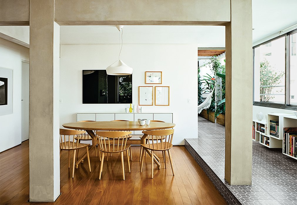 Architects Simone Carneiro and Alexandre Skaff used materials like cement-tiles and perobinha wood to make a fomerly cramped São Paulo apartment feel more open. Re-envisioning an under-utilized terrace as a lush garden certainly helped as well.