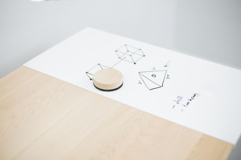 Both the sitting and standing versions of DESK 01, a collaboration between Artifox and IdeaPaint, are outfitted with dry erase surfaces for recording sudden bursts of creativity.