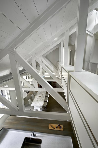 The second-story, basically a catwalk that threads between the large, exposed trusses, is mostly residual space used for storage.