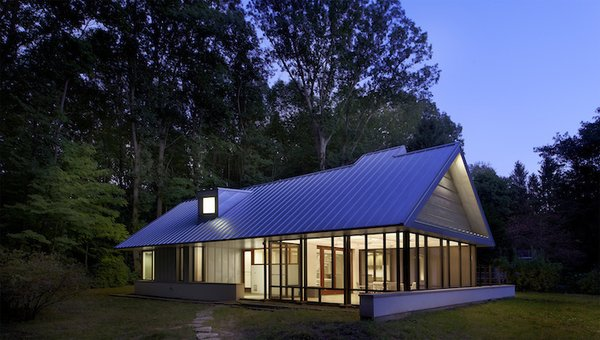 The home is clad in galvalume, a low-maintenance, zinc-coated metal, to make upkeep easier. Prefabricated, 10- to 12-inch-thick panels in the roof provide insulation, and the low walls are packed with limestone.