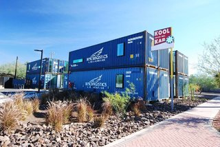 The eight container apartments, huddled together in a wise use of the space, are situated on an old used car lot in downtown Phoenix. A decommissioned container costs between $1,800 and $5,000, says architect Wesley James. Transportation, handling, and site assembly run at least as much.