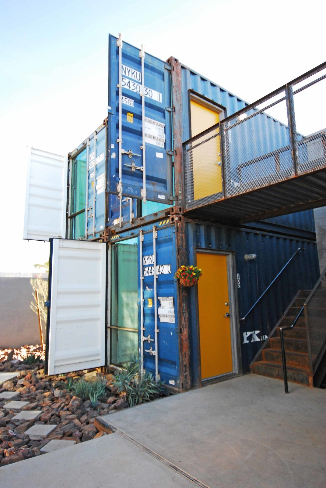 Exterior, Metal Roof Material, Apartment Building Type, Shipping Container Building Type, Metal Siding Material, and Flat RoofLine Floor-to-ceiling windows front each unit, with sections of container wall folded out and fixed in place as part of the shading strategy.  Photo 3 of 8 in New Shipping Container Apartments Bring Market-Rate Rent to Downtown Phoenix