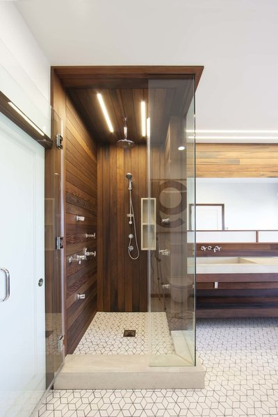 Lighting in the bathroom is provided by San Francisco-based Aion LED's modular fixture system. The linear lighting mimics the redwood siding.