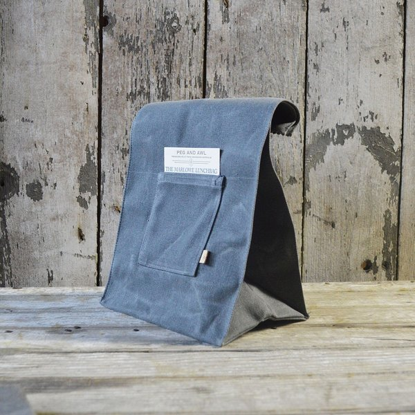 Marlowe Waxed Canvas Lunch Bag, $44 at the Dwell Store  The Marlowe Waxed Canvas Lunch Bag from Peg and Awl recalls the classic look of a traditional paper lunch sack, but in a sturdier and more sustainable form. Inspired by friend Katie Marlowe—for whom the bag is named—the lunch bag contains a small pocket, meant for passing a note to whoever will use the bag.