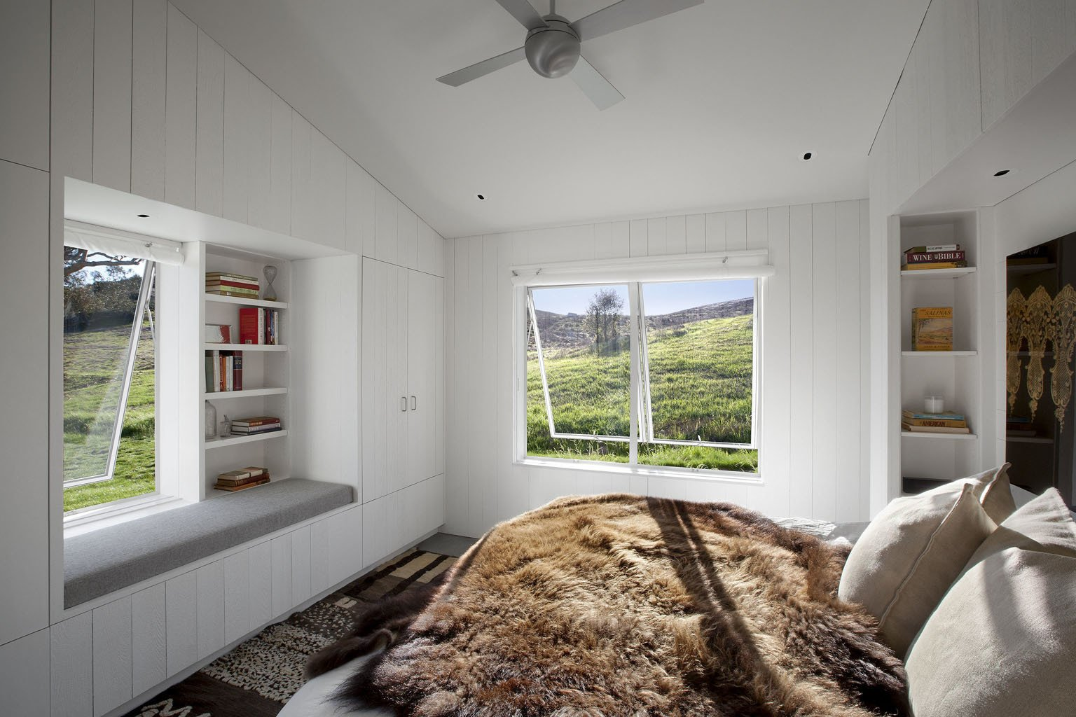 The overall design objective was to create a home that used the surrounding landscape as a dominant feature. Blomberg Window Systems panes open the master bedroom to the outdoors.  A LEED Platinum Family Home Takes the Place of an Abandoned California Farmhouse  by Kelly Dawson