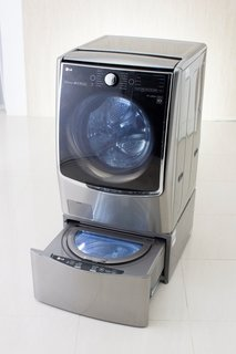 Not only does LG's new Twin Wash System allow for the simultaneous washing of two separate loads (the mini-washer is suited for delicates that require unique wash settings), it also allows users to download preprogrammed wash cycles to a smartphone and activate them by simply tapping their phone to a sensor on the appliance.