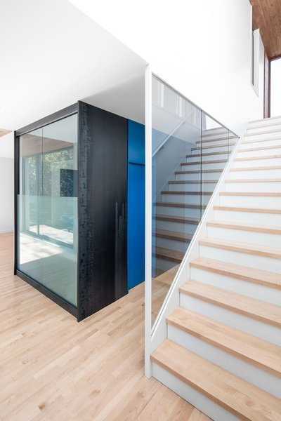Enfer Design also crafted the maple stairs and the adjacent hot-rolled steel window encasing.