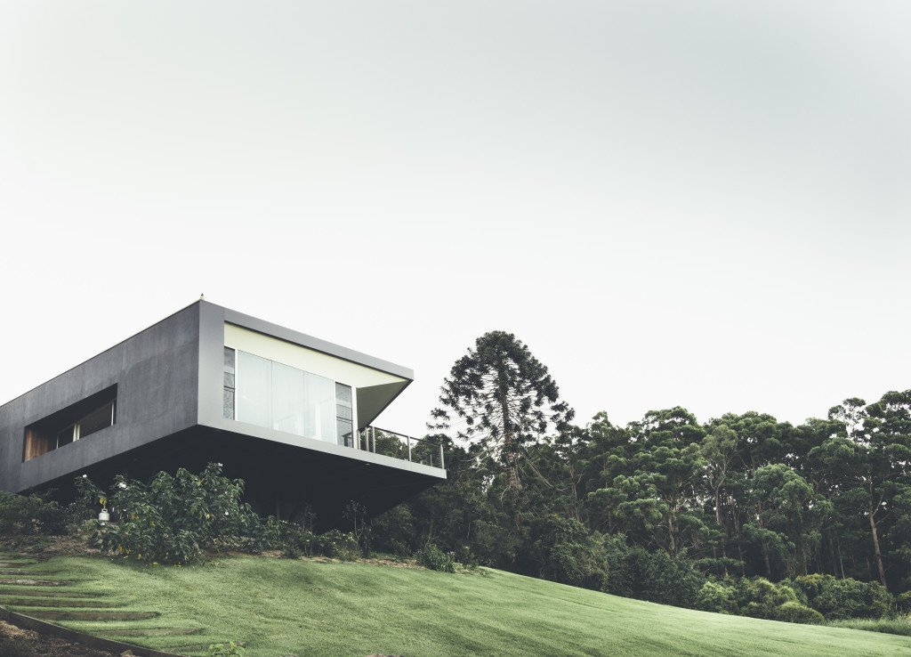 Grass, Exterior, House Building Type, Concrete Siding Material, Glass Siding Material, and Flat RoofLine Teeland Architects designed this modern home on Australia's Sunshine Coast in order to maximize views of the Pacific Ocean to the east as well as the surrounding forest to the north.  Photos from Modern House Captures Panoramic Views in Australia