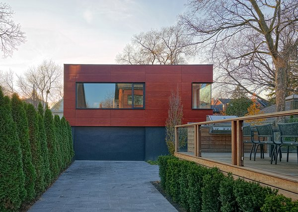 """The outdoor deck is made from ipe. The wood was selected to complement the fumed oak flooring inside the house. """"We carried the level of design detail throughout [the property] because we wanted the exterior to feel like an extension of the living space, especially for entertaining, but also as a connection to the coach house,"""" Dubbeldam says."""