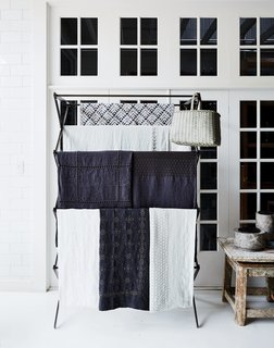 Linens from Society Limonata hang in the shop.