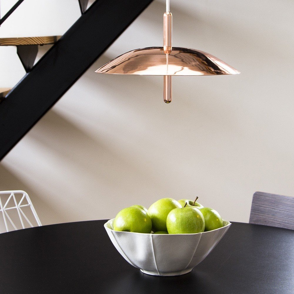 "Signal Pendant Light, $495–$695 at the Dwell Store  Inspired by satellites and stars, the Signal Pendant Light from Brooklyn–based Souda is meant to resemble a celestial body. It features a perforated metal shade that provides a distinctive light diffusion.  Search ""norm lunch plate"" from Meet the Dwell Store Best Products of 2015"