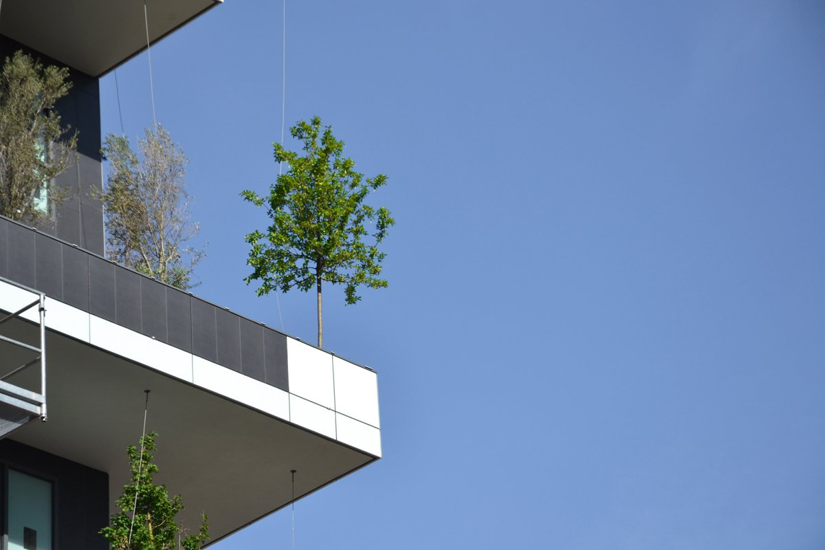 The plant life filters dust particles, absorbs carbon dioxide, and protects the building from radiation.  Photo 4 of 5 in Pair of Skyscrapers Sneak a 2,800-Plant Park into Milan