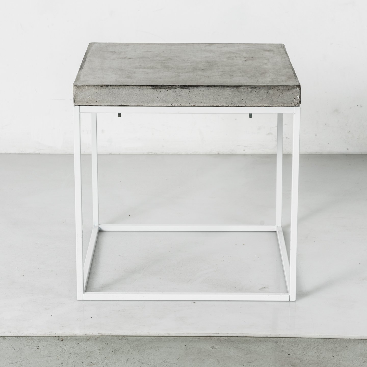 The Oakland table is topped by a raw-concrete slab.  Concrete Obsessed