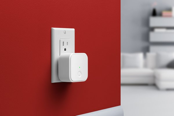 """Without WiFI assistance, the Bluetooth-compatible August Smart Lock relies on digital """"keys"""" to unlock the front door, enabled only when the keyholder is within immediate range. The new Connect device taps into internet service to allow locking and unlocking from anywhere and to keep an eye on any door activity remotely."""