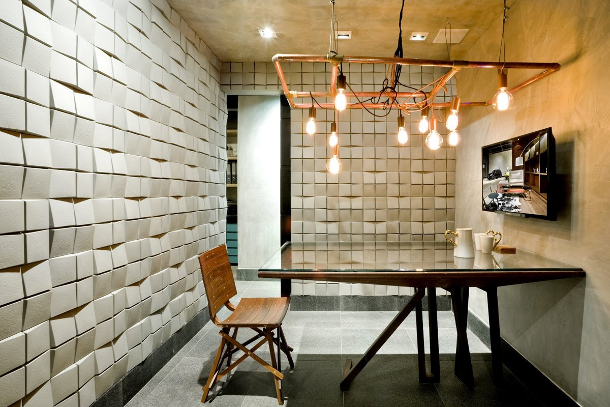 """The office design was inspired by """"blues, jazz and Bossa Nova."""" Tiled walls help optimize acoustics.  Office from We Love this Cozy Brazilian Office (And Its Friendly Office Cat)"""