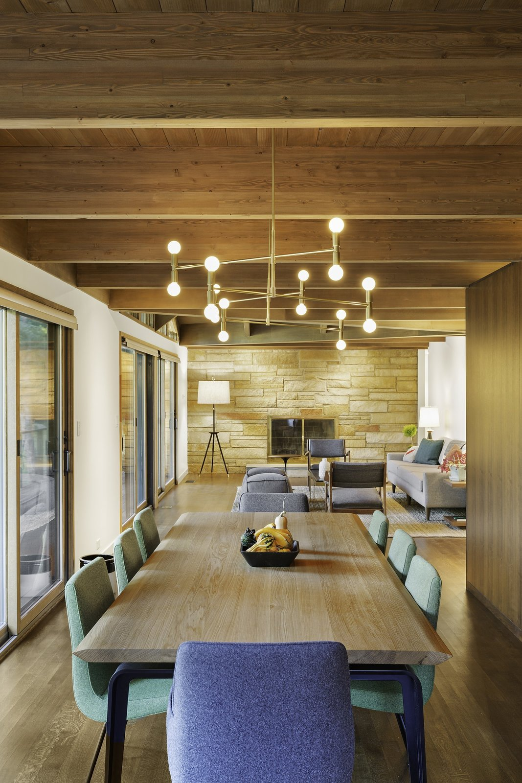 """""""The new floor plan is considerably more open than the original plan, and the interior and exterior details have been simplified and made consistent,"""" Schultz said. A Lambert & Fils light fixture illuminates a dining set by Ligne Roset.  City Skyline by Kelly Dawson"""