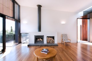 Immediately to the right of the entry is the main living space, which features a Jetmaster 700D wood-burning fireplace.