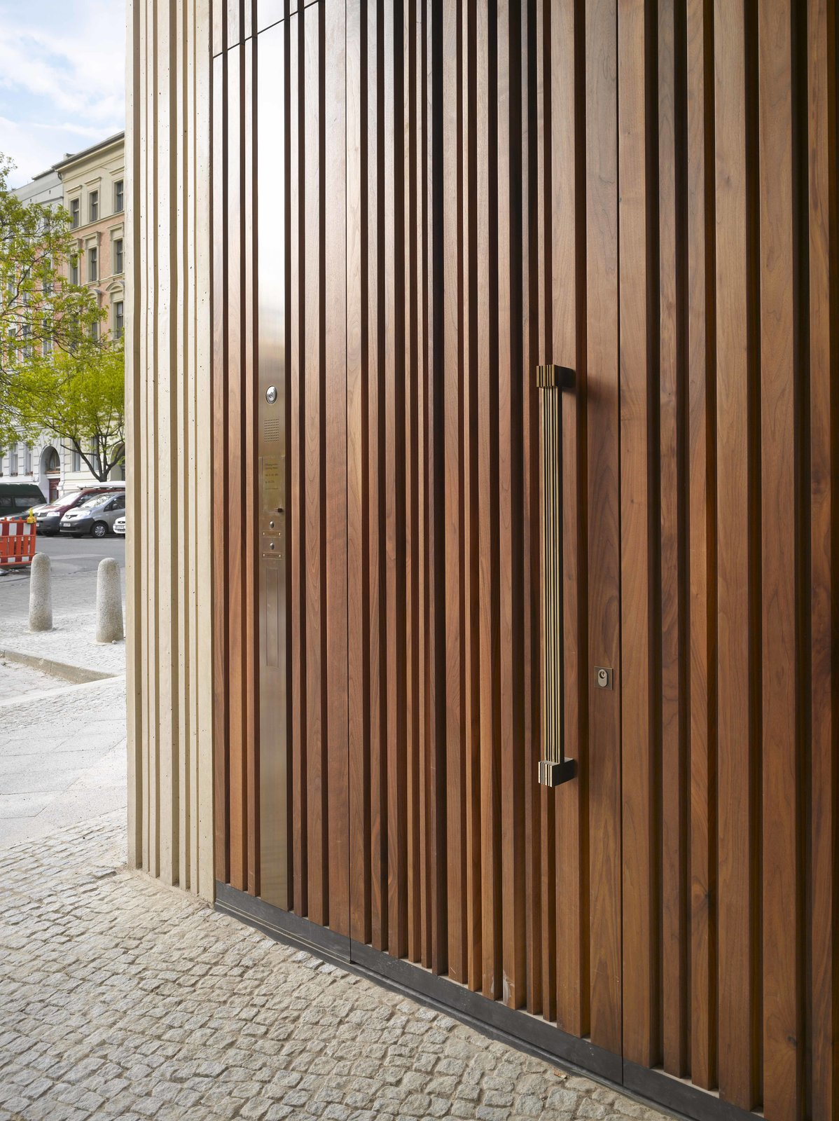 Doors, Swing Door Type, Exterior, and Wood The Museum for Architectural Drawing in Berlin, designed by Russian firm SPEECH Tchoban & Kuznetsov, has a wooden door that mimics the structure's textured concrete exterior.  Photo 10 of 10 in Take a Peek Through These 10 Modern Front Doors from Stunning Architectural Drawing Museum in Berlin