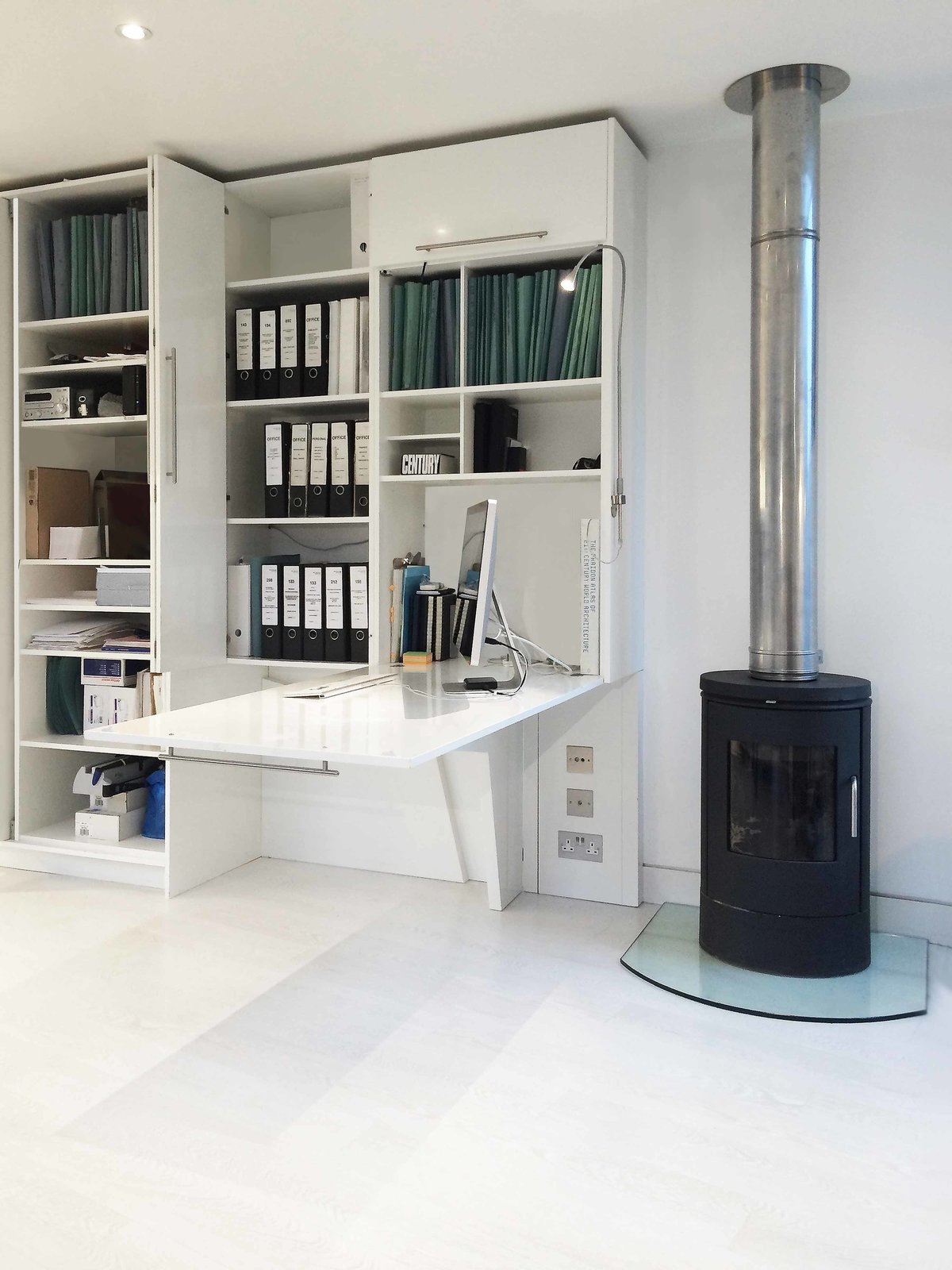 The workstation extends directly from the wall, saving space underneath.  Photo 6 of 7 in A Tiny Live/Work Addition Crowns a Historic London House