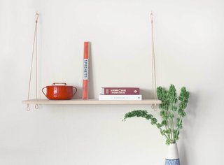 """The Suspended Pine Shelf was inspired by a Spanish colonial kitchen shelf that Deming and Gant noticed in a rustic 1700s Spanish Home in Saint Augustine, Florida. Deming notes, """"it was such a simple, functional, and appealing design that was originally used to keep food away from household pests."""" Deming and Gant used that piece as inspiration for their pine shelf, paring it down to a similarly spare, but more versatile storage solution. Although Yield Design Co. refers to the shelf as a Pantry Shelf, Deming notes that the shelf has been used """"in living room settings as well as in commercial settings for product display."""""""