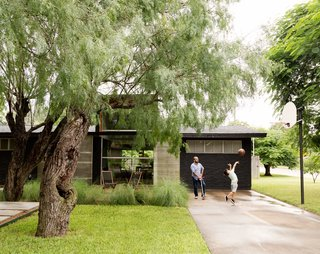 López insisted on a concrete pathway that winds through the trees, so visitors don't have to enter through the driveway.
