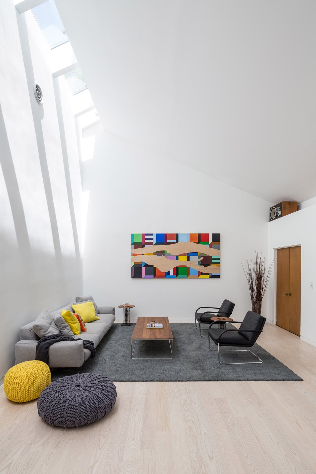 Living Room, Chair, Sofa, Coffee Tables, and Light Hardwood Floor Architect Dan Brunn's #9 Dream House captures the contemporary style of the designers Dwell selected for Decorist.  Photo 1 of 1 in Dwell Teams with Decorist to Make Getting Modern Interior Design Easy