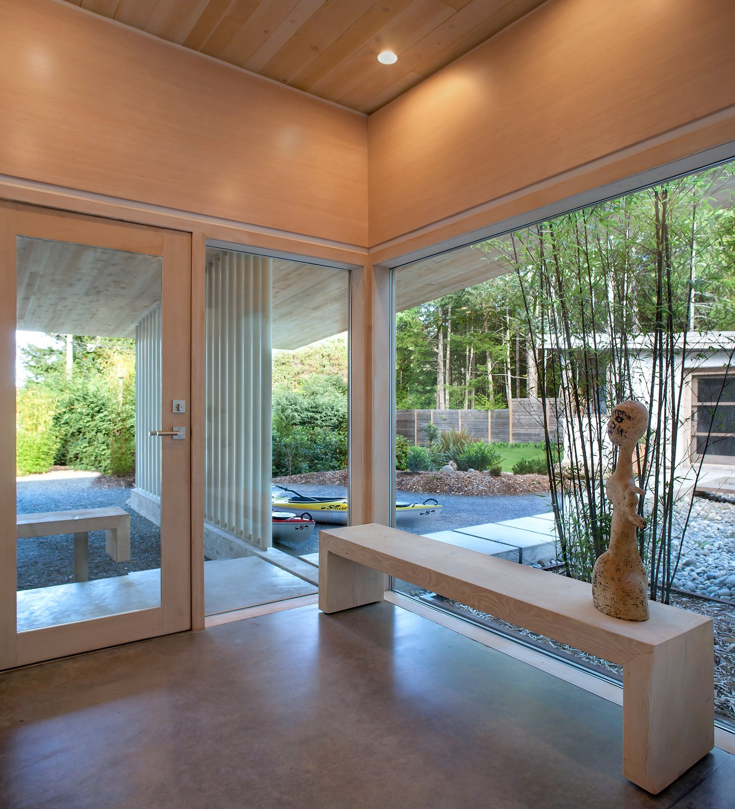 Polished concrete with radiant heating comprise the cabin's interior floors, and its ceilings are made of Douglas fir. Jones designed the custom windows, which were fabricated by contractor Ian Maclean.  Photo 4 of 10 in A Couple's Cherished Vacation Home is Given a Second Life