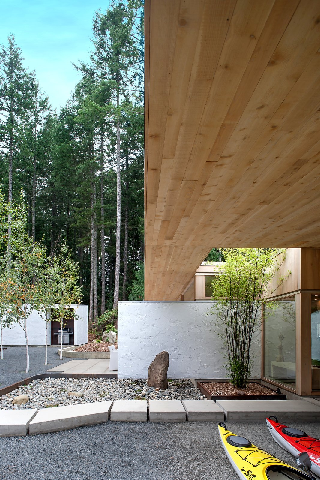 """Their lives revolve around ocean activities, reading, music, and good food and wine,"" Jones says of the owners. ""The new house I designed is just for them,"" such as with this sheltered outdoor areas where gear can be stored; the ceilings above are also Douglas fir.  Cabin"