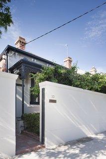 As a nod to local history, the designers kept the home's original street-facing Victorian facade.