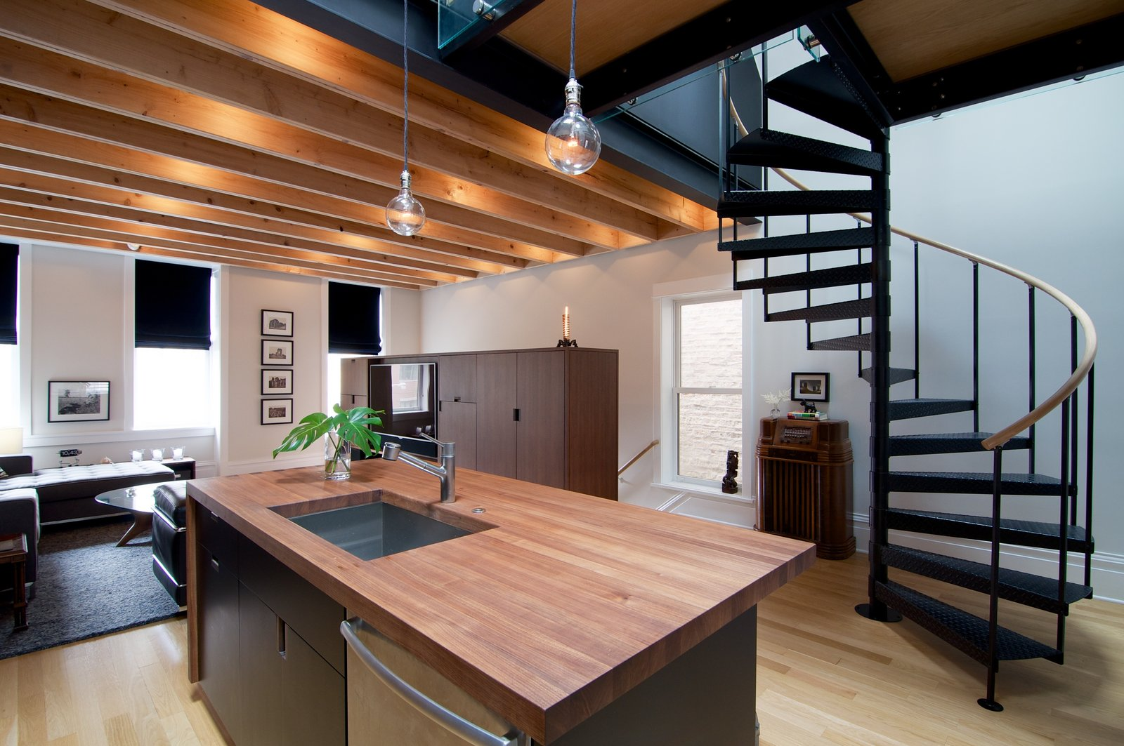 Wherever possible, Shively looked to work with local craftsmen. For example, all of the cabinetry was made by Lambright Woodworking, an Amish company in Indiana, and custom doors and trim were made by Jarzab Construction, a team of local Polish carpenters.  Photo 2 of 8 in A Chicago Renovation Taps Into its Attic to Almost Double its Square Footage