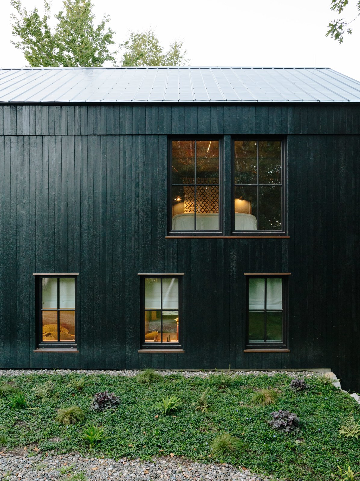 "Exterior, House Building Type, and Wood Siding Material The main house is constructed from structural insulated panels from Vermont Timber Frames and clad in charred cedar. The roof panels are by Agway Metals.  Photo 3 of 13 in A Passive House and ""Sauna Tower"" Join a 19th-Century Barn in the Hudson Valley"