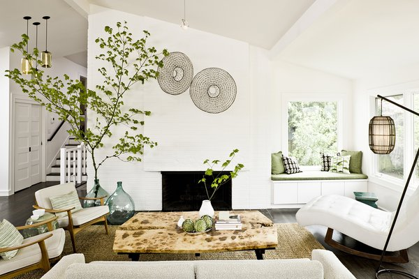 Jessica Helgerson Interior Design updated a split-level ranch house in Portland by introducing a clean white palette and vintage furnishings.