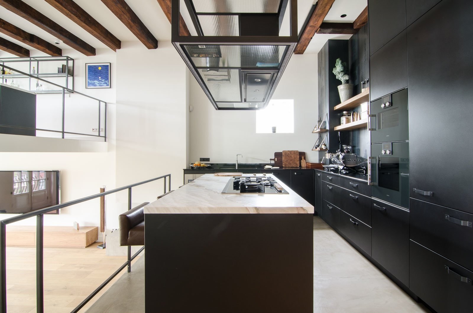 Kitchen, Marble Counter, and Metal Cabinet On the side of the home that faces the canal, the main kitchen's aesthetic is decidedly elemental. Custom Eginstill hot-rolled steel cabinetry with recessed Gaggenau appliances surround a Carrara marble island.  Bloemgracht by Sarah Akkoush