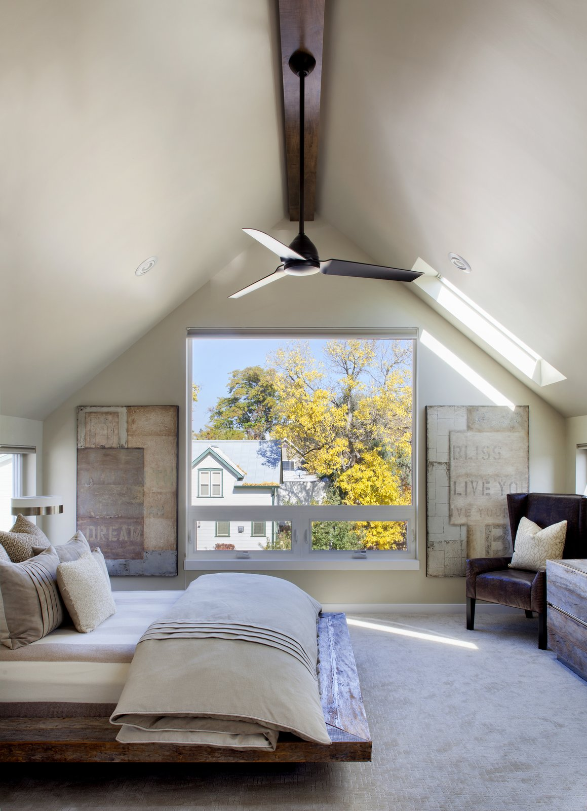 Bedroom, Chair, Recessed Lighting, Carpet Floor, Table Lighting, Bed, and Dresser Since this home was primarily for the couple, rather than their grown children, they wanted a luxurious master bedroom. A Kichler fan circulates air above the bed.  Modern Homes in Colorado by Luke Hopping from Highlands House